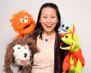 Through me to you_portrait_smile Puppeteer Leigh Baltzer and her co-stars. Photograph by Nicolas Hyacinrthe.